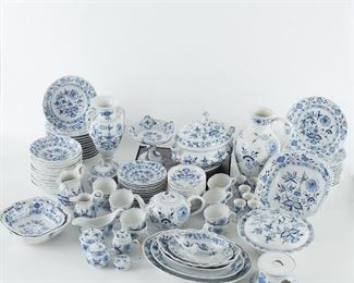 Meissen porcelain dinner service in the Blue Onion pattern. All marked with the crossed swords mark under the base. Comprised of twelve dinner plates; twelve salad plates; twelve large coupe bowls; twelve small coupe bowls; twelve soup bowls; one teapot; twelve teacups; one creamer; one sugar bowl; two other lidded condiment bowls; six egg cups, two gravy boats, one with attached under plate; four oval platters of varying sizes; three square platters of varying sizes; one vase; two pitchers of different sizes; two large tureens; two small tureens; one cake platter; and one warmer. SKU: 01289 Follow us on Instagram: @revereauctions