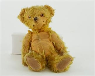 Group of three Steiff style teddy bears, c. early to mid 20th century. All with glass eyes. The yellow and dark brown bears have movable joints.  Follow us on Instagram: @revereauctions