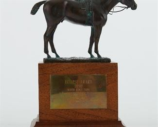 """1989 Eclipse Award trophy, won by North Ridge Farm. The trophy was designed by Adalin Wichman and is made up of a bronze sculpture of a horse on a walnut base. Plaque on the base reads: """"Eclipse Award; 1989; North Ridge Farm; in Recognition of Singular Dedication to, and Outstanding Achievement in, the Breeding of the Thoroughbred."""" Foundry mark along the base. SKU: 01907 Follow us on Instagram: @revereauctions"""