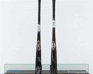 Group of two signed, game used baseball bats. One is signed by Tim Raines Jr. The bat has some hairline cracks along the taper, thick application of pine tar to the handle, and clear white signature along the barrel. The other bat is signed by Los Angeles Dodgers and Arizona Diamondbacks player Trent Oeltjen. The lot also includes a display case for one bat. The case has a interior crack.  SKU: 01206 Follow us on Instagram: @revereauctions