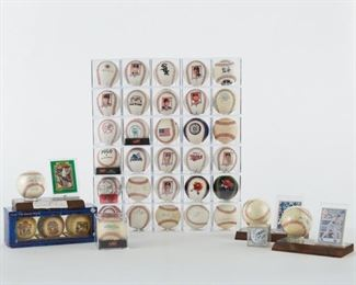 Group of signed and unsigned, game used baseballs. The signed balls include three card and ball combos which include Bob Feller, Reggie Jackson, and Don Mattingly. The single signed baseballs include a golf ball signed by Mickey Mantle, Jason Conti, Pee Wee Reese and Matt Williams. There is also a large group of commemorative balls with facsimile signatures and some game used balls.  SKU: 01210 Follow us on Instagram: @revereauctions