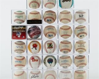 Group of signed and unsigned, game used baseball. The signed balls include Ken Griffey Jr, Andy Lopez (manager of the University of Arizona 2012 National Champions), Scott Erickson, Frank Howard, Arizona Diamondbacks signed baseball, and others. There is also a large group of commemorative balls with facsimile signatures and some game used balls.  SKU: 01209 Follow us on Instagram: @revereauctions