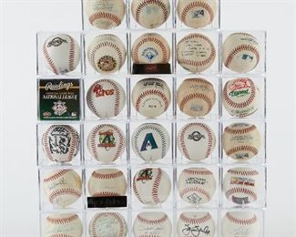 """Large group of signed and unsigned, game used baseballs. The signed baseballs include Pete Rose, Al Kaline, Mario Andretti, One Tucson Toros 1996 Team signed ball, Enos Slaughter, Brandon Webb, a baseball with an inscription """"1st Pitch AZL Champ. Game 8.31.08 P: Mullins 1: Hensley 2: Gaddy 3: Lentz,"""" one New York Yankees team signed ball with signatures from Steve Howe, Wade Boggs, and Buck Showalter. There are also a number of game used and special edition balls.  SKU: 01208 Follow us on Instagram: @revereauctions"""