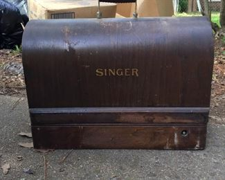 Antique Singer sewing machine in wood carry case