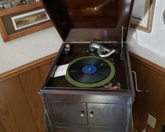 Vintage Victrola record player and records