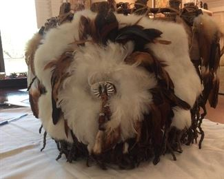 Native American basket with rabbit fur and feathers