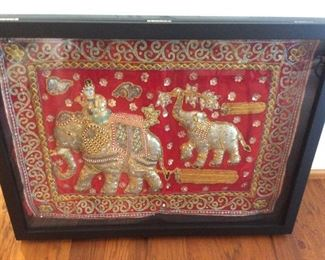 Indonesian fabric art in shadow box
