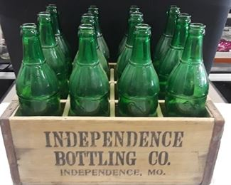 Independence Bottling Company Case with 12 Independence Bottling Company Bottles AKA Polly Pop Bottles