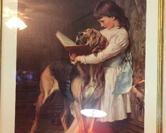 girl is teaching dog to read