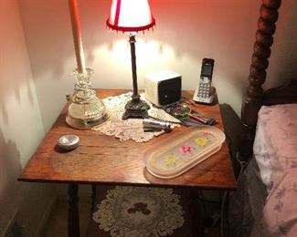 primitive side table topped with boudoir lamps