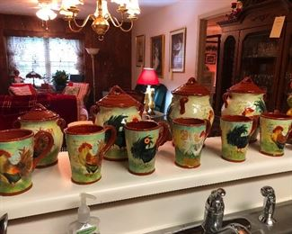 A serious collection of rooster-themed mugs