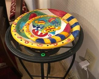 fun jazzy looking plate duo and swirly footed accent table
