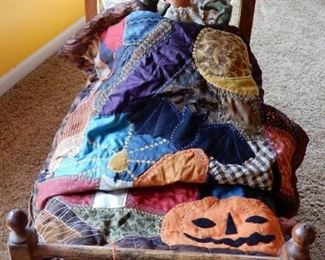 """HERE IS THE GHOUL WHO  HEARS A """"BUMP IN THE NIGHT"""" IN AN ANTIQUE BED AND HOLDING A WONDERFUL QUILT BY SCOTT SMITH."""