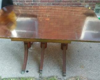 Real nice antique wood table with 3 leaves. 4 chairs.
