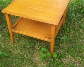 Solid wood end table with glass top.