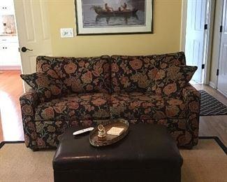 Loveseat, ottoman, area rug