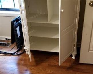 2 White storage cabinets