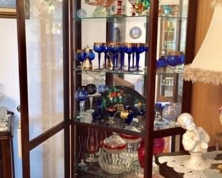 Display case with stemware and Murano glass
