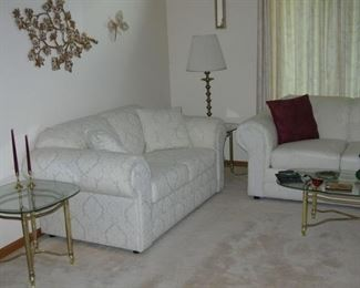 sofa and loveseat, brass and glass tables