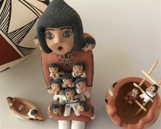 Acoma pottery story teller doll and pottery bowl.