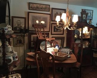Looking into the Dining Room, wonderful art, great tiger oak table with large lion feet, oak chairs, vintage chandelier