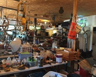 Another view into the garage, tools galore, more books, industrial items and lots of chandeliers