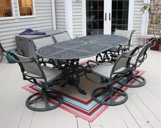 Metal patio set with 6 swivel chairs