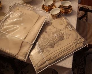 Two Italian hand embroidered never used tablecloth & napkins
