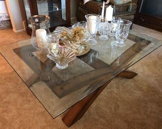 Modern glass top coffee table w/ beveled edge and wood base