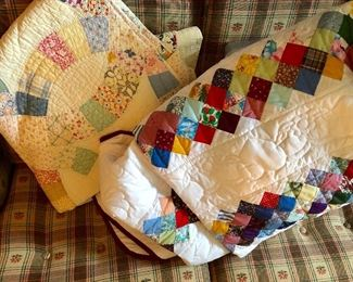 Many new quilts (quilt on left handmade, vintage)