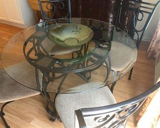 evil twin of earlier wrought iron glass-top dinette set
