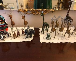 Menagerie of miniature giraffes plotting the overthrow of society