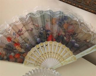 ornate fan for when you're a famous fashion designer