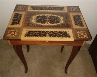 I am a beautiful little table that opens up to a music/jewelry box! Look at my inlay top!