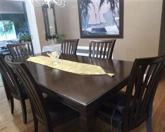 Dining Table with six chairs.  Custom table pads available for sale.