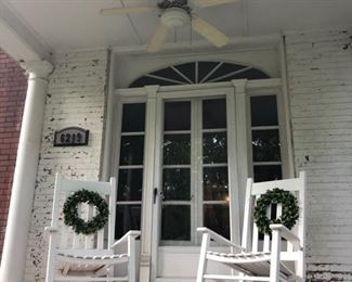 Two white rocking chairs