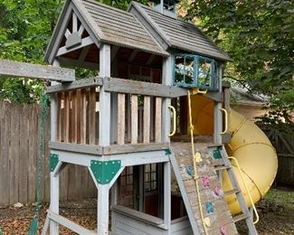 Large children's play swing set. 20 feet by 12 feet tall.