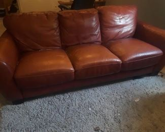Leather sofa and matching chair.  Chair has some damage.