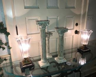 Pedestals.  Antique fluted glass lamps.