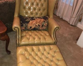 Leather tufted wingback chair and ottoman