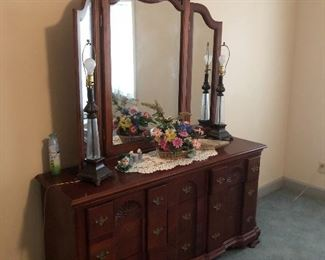Dresser with triple folding mirror