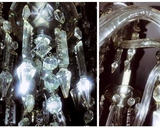 Close-up detail of Cut glass chandelier arms and crystals