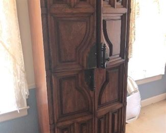 Armoire matches bedroom furniture.  Stanley.  One door handle is off