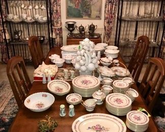 Dining room table staged with gorgeous china sets