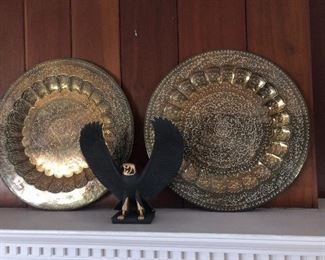 Two large brass trays.  Eagle statue