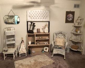 Twin tufted headboard, wicker rocker.  Stacking tables, Victorian corner shelf.  Shag rug.