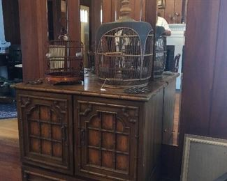 Cabinet.  Old bird cages