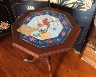 Small table, needlepoint.  Note the chewed foot on the left.