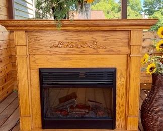 Electric fireplace. Gives off heat and can change the lighting