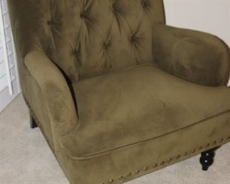 Olive green velvet armchair.